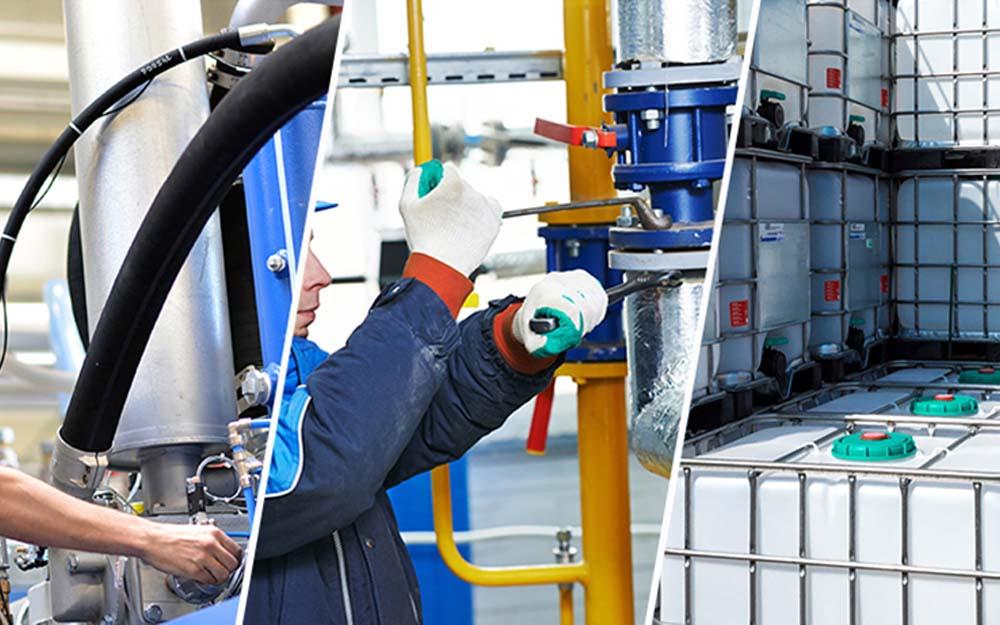 Einen Arbeiter montiert ein Rohr an einer Kühlschmierstoff Leitung. IBC Container stehen auf einem Firmengelände.